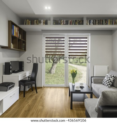 Big window with blinds in modern, grey living room #436569106