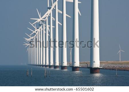Big windturbines along the Dutch coast #65501602