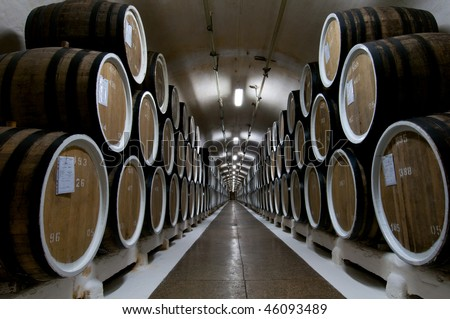 Big wine barrels in a wine cellar - stock photo