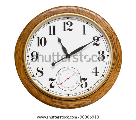 Big wood wall clock on white, isolated with clipping path