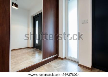 Big Wooden Closet With Mirror On The Door