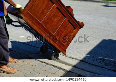 Big wooden Desk on trolly being moved onto street