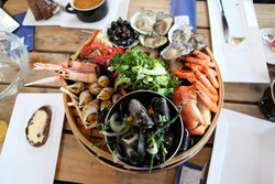 Big wooden dish with the set of seafood. Mussels,prawns, crab