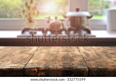 big wooden table and kitchen space