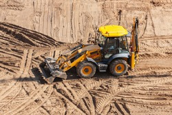 Big yellow excavator, dozer shovel on the construction site.