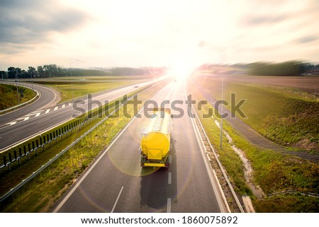 Big yellow truck tank, on the roads of Europe. Logistics and Transport Сток-фото ©