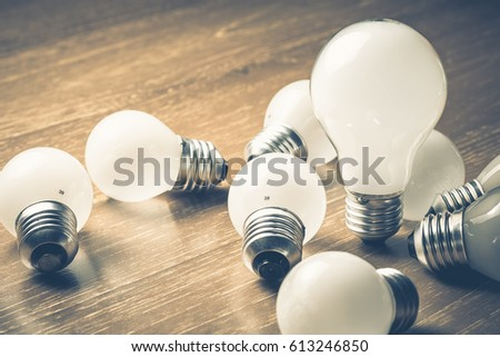Bigger light bulb among the small ones #613246850