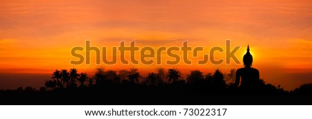 stock photo : Biggest buddha statue in sunset background