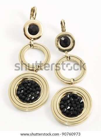 Bijouterie, earrings of yellow metal, isolated