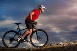 Bike adventure travel photo. Bike tourists ride on the countryside downhill.