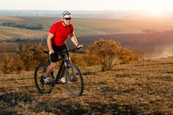 Bike adventure travel photo. Cyclist on the Beautiful Meadow Trail on sunny day.