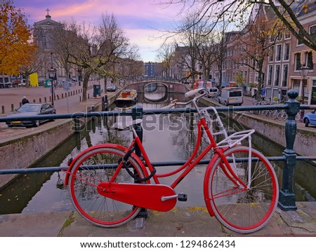 Bike at the canals in Amsterdam Netherlands at sunset