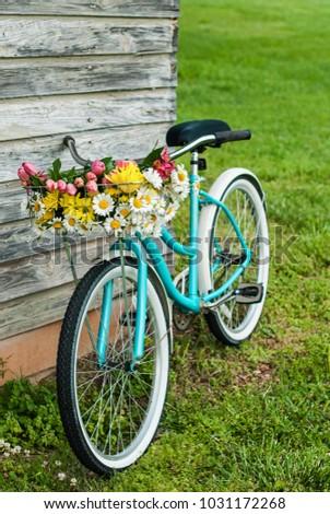 bike basket of flowers in...