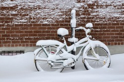 Bike covered with fresh snow in Montreal