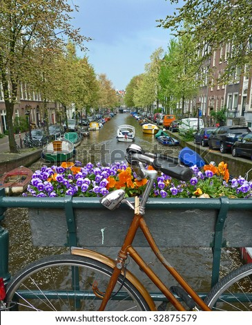 Bike flowers and canal. Amsterdam, Netherlands