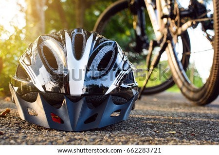 Bike helmet and bike on the street and evening sun