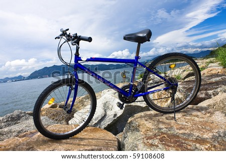 bike in the sea bay and blue sky