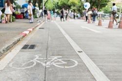 Bike lane and bike symbol on the street.