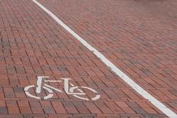 bike lane on road, bike path with pictogram