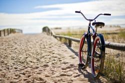 Bike left on sandy beach trail
