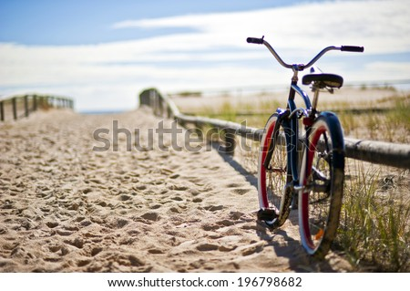 Photo of Bike left on sandy beach trail