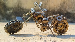Bike Model made of scrap materials, Small Metal motorbike made out of scrap metal pieces. Close up (macro) of handmade metal toy motorcycle/motorbike made out of scrap metal pieces with short depth