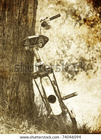 Bike near tree. Photo in old image style.