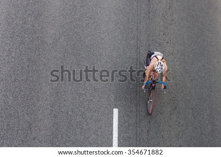 Bike on the asphalt road, top view