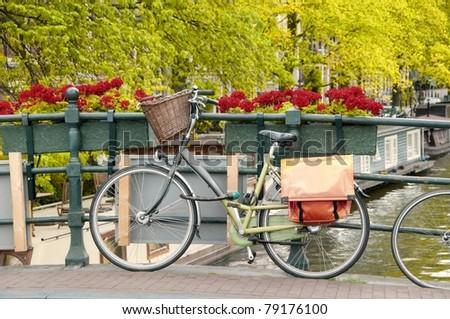 Bike parked on a bridge in Amsterdam, Netherlands