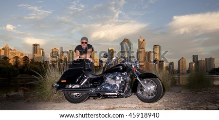 Bike rider with city backround - stock photo