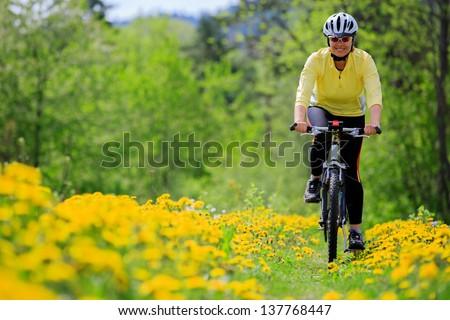 Bike riding - woman on bike, healthy lifestyle concept