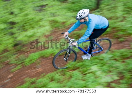 Bike riding - woman on bike (intentional motion blur)