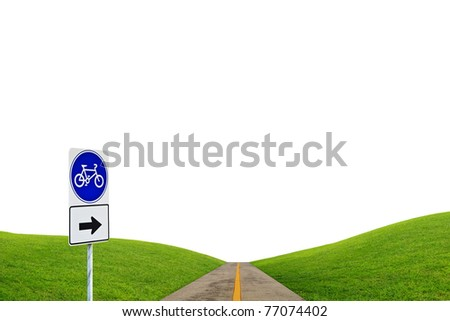 Bike sign with bicycle path and green hill