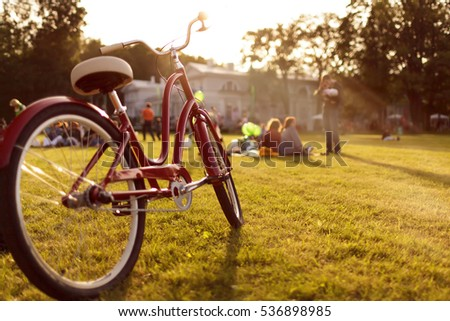 bike stands on green grass in...