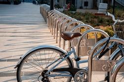 bike strapped to a long empty city bike parking lot