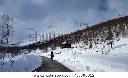 Bike tour and Ski tour to the top of Hurrungen in Norway #730988812