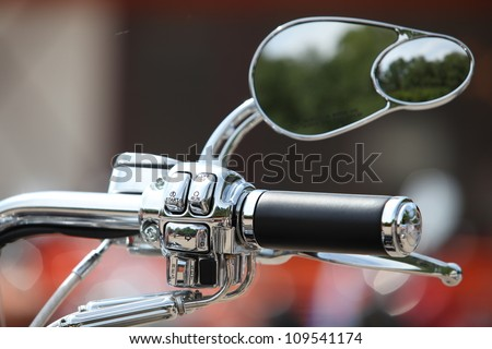 bike wheel and rear-view mirror
