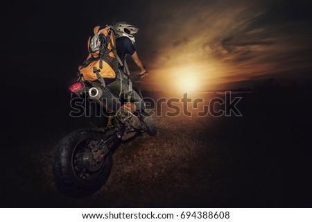 biker and sunset #694388608