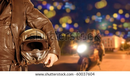 Biker closeup at night city background
