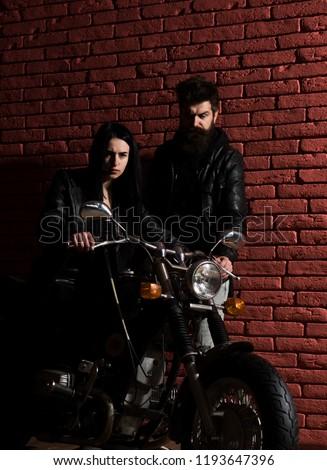 biker couple. biker couple in leather jacket. sexy biker couple with motorcycle. biker couple travel on motorbike.