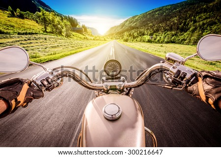 Biker driving a motorcycle rides along the asphalt road. First-person view. #300216647