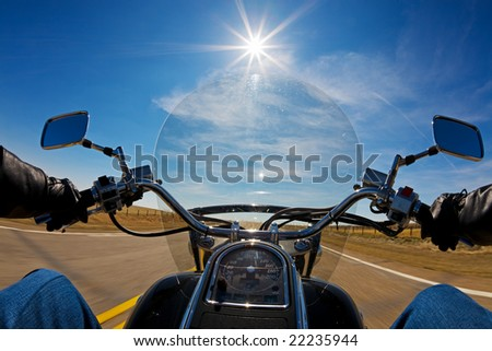 Biker enjoying a ride in the country side on a sunny day
