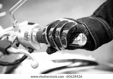 Biker hand rests on the steering wheel motorcycle ( black white )
