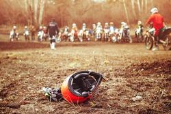 biker helmet lying on the ground next to the gloves