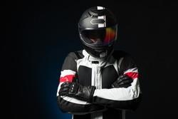 Biker in protective suit with a helmet
