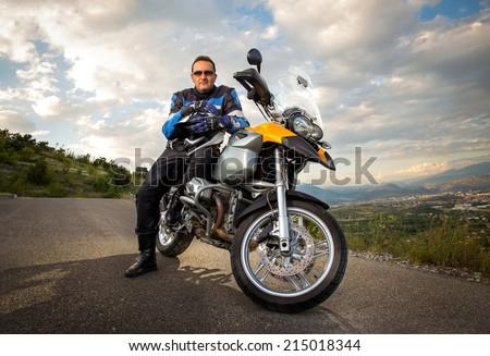 Biker man sitting on his motorcycle