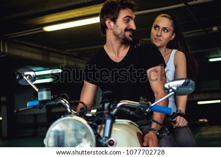 Angry biker girl facing motorcycle man images and stock photos