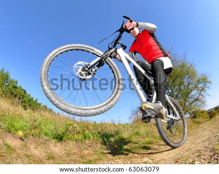 Biker photographed fisheye - stock photo