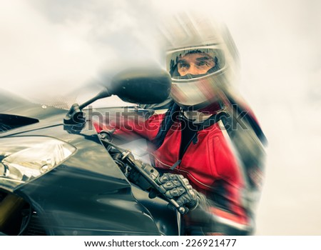 biker riding fast on his sport motorbike. speed blur effect