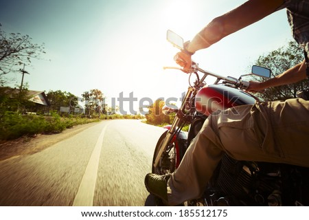 biker riding motorcycle  on an...